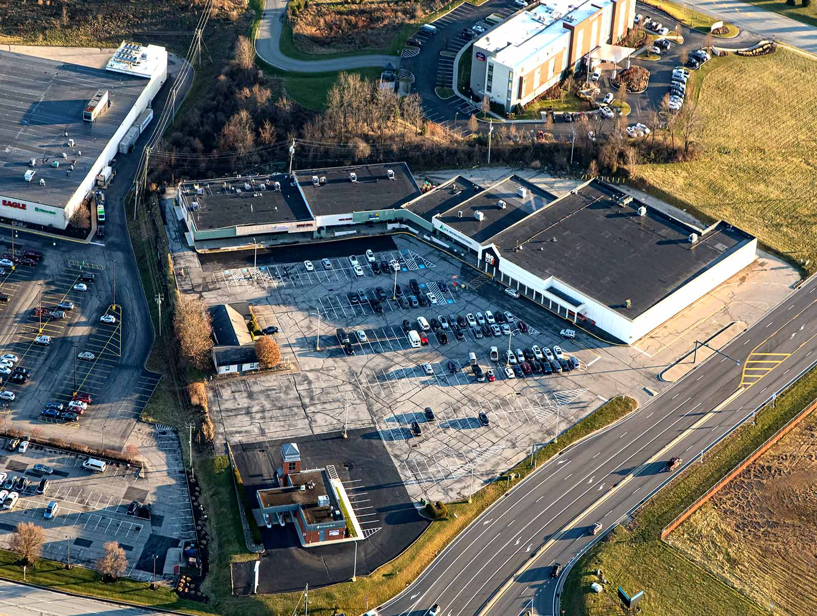 Aerial view of large shopping center plaza.